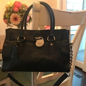 Black Michael Kors small lock bag